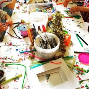 Hiring a Children's Entertainer Hosting Art and Craft Table at a Party