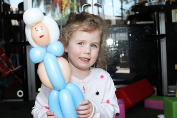 Girl holding princess balloon