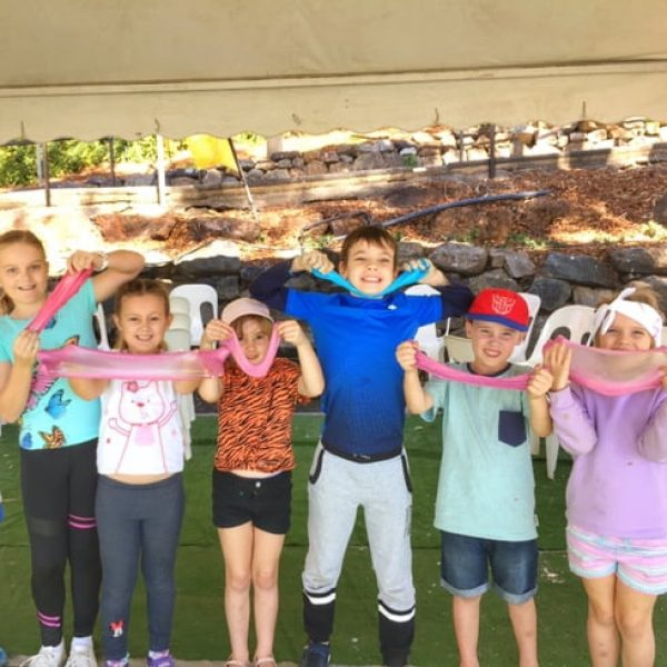 Children showing their new glue slime at a slime party in melbourne