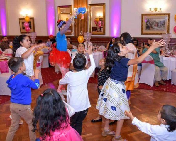 kids entertainer blowing bubbles