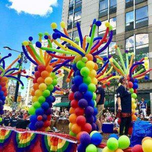 Rainbow Balloon Decorations on Parade Float