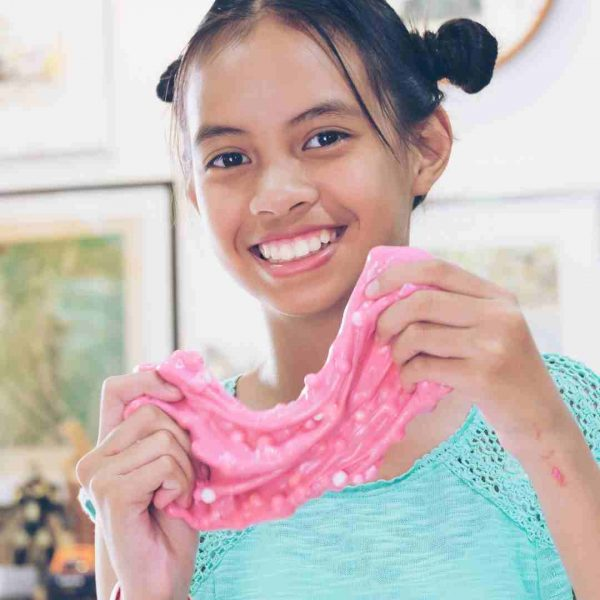 Child playing with pink slime at a children's science party