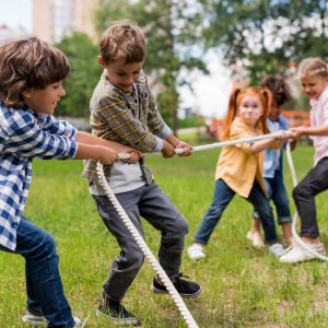 Kids playing tug of war at a birthday party