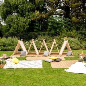Teepees on the Grass with Rugs