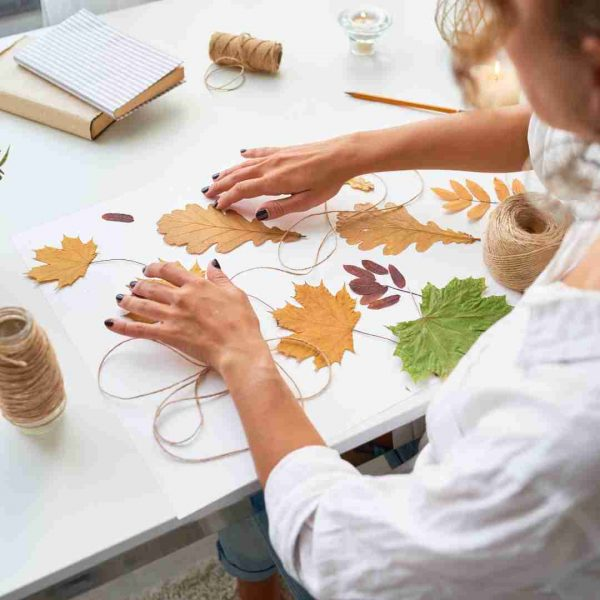 Kids making natural crafts with leaves