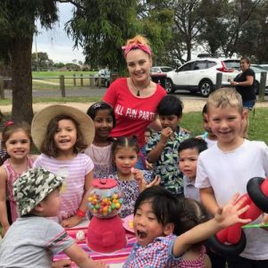Hiring a Children's Entertainer Posing with Kids at Party