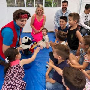 Kids Magician Showing panda puppet