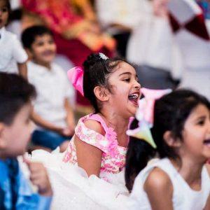 kids laughing at magic show