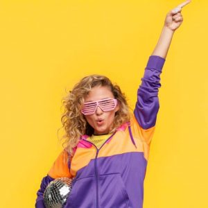 Lady in Colourful Clothes Holding Disco Ball on Yellow Background