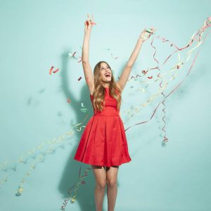 Woman with Streamers on Blue Background