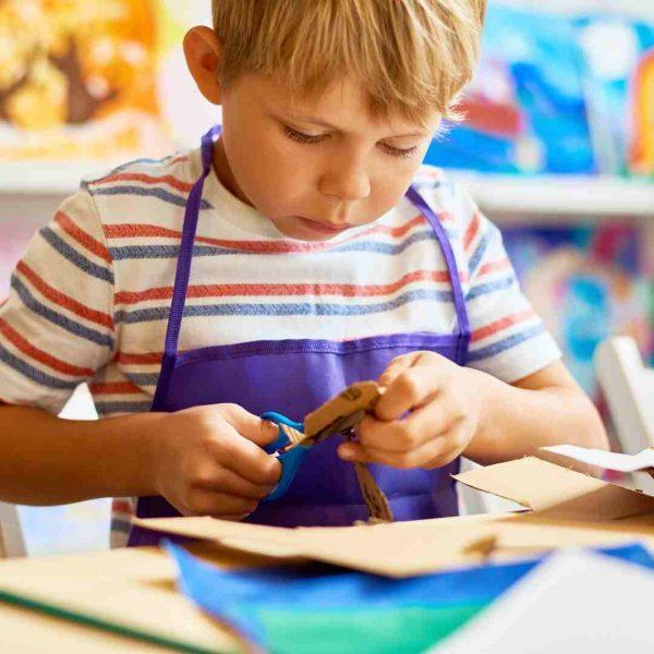 Kid using scissors
