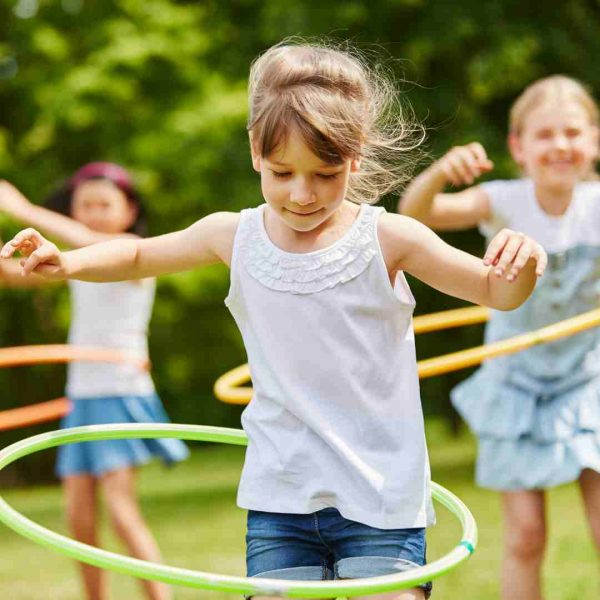 Kids hula hooping
