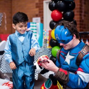 Hiring a Children's Entertainer in Captain America Costume doing Temporary Tattoos