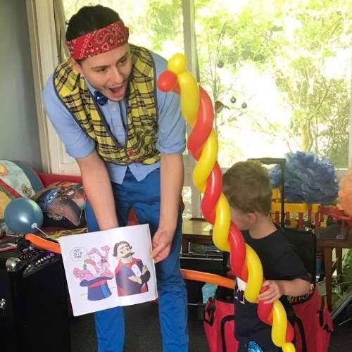 Children's Entertainer Showing Magic Trick