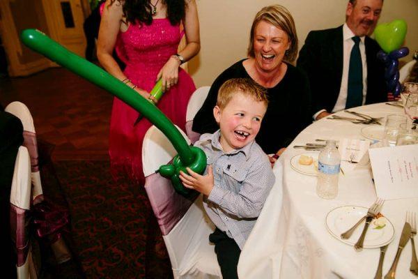 Boy holding sword balloon