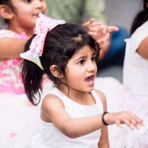 "Child saying ""abracadabra"" while waving hands"