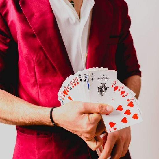 Magician Holding Deck of Cards