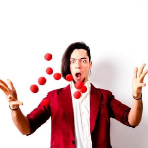 Magician with Levitating Balls