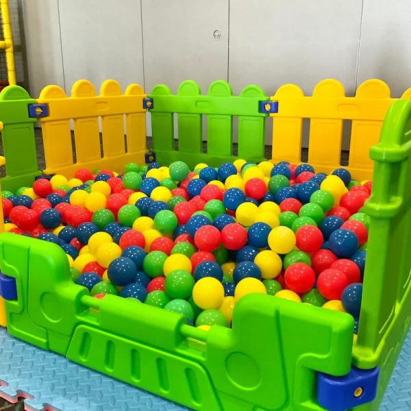 Green and Yellow Fences Around Ball Pit for Kids Party Hire