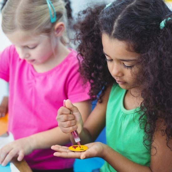 Kids Doing Art and Craft at a Party