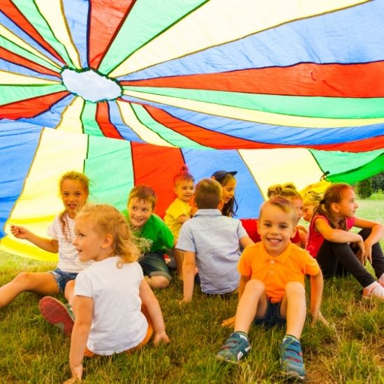Kids Under Colourful Parachute at Kids Party