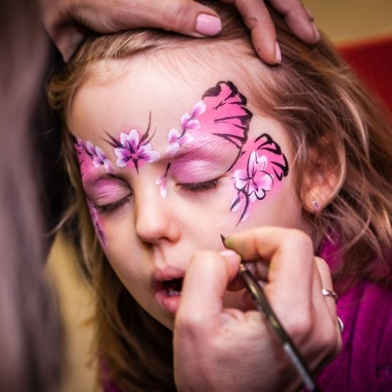 Girl Getting Butterfly Face Painting