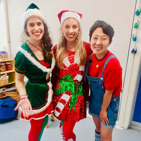 2 Christmas Elf Entertainers with a Party Host